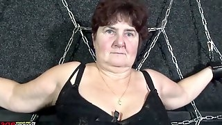 Chained chubby granny Hana gives a blowjob standing on her knees